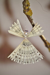 selective-focus photograph of paper angel ornament