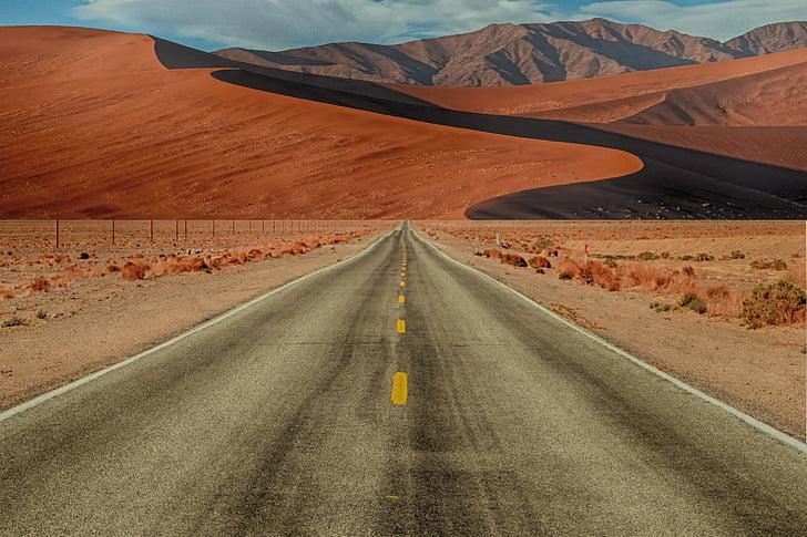 gray asphalt road in desert