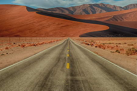 gray asphalt road in desert