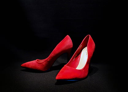closeup photo of red leather pointed-toe heeled shoes