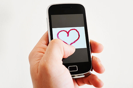 black smartphone showing red heart illustration
