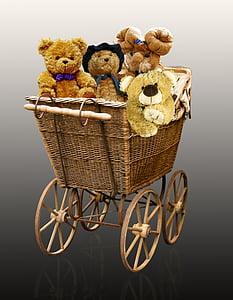 four bear plush toys in brown wicker pram stroller