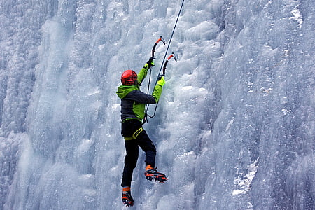 person ice climbing with harness