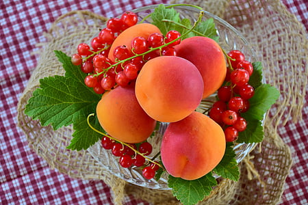 peach fruit on glass bowl