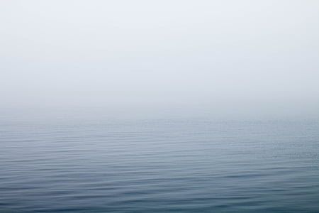 calm ocean water with fog
