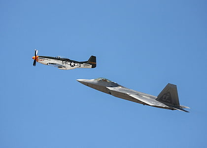 two white and gray monoplanes