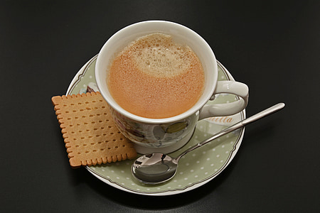 white and gray ceramic cup on saucer