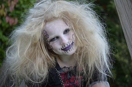 smiling girl wearing halloween costume