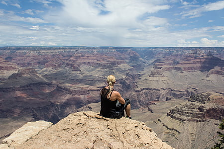 woman on cliff on rock formation