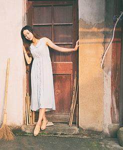 woman ' white sleeveless dress
