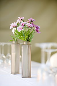 selective focus photograph of purple petaled flowers with vases