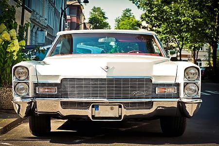 classic white car near building