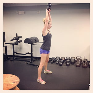 woman lifting a kettle bell