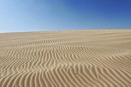 beige desert sand at daytime