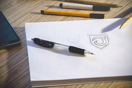 black click pen on white book