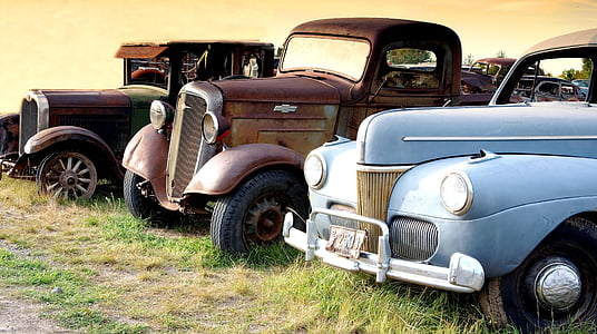 three assorted cars