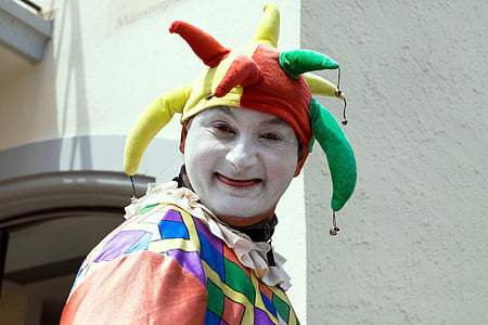 person in clown costume near wall