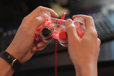 person playing game controller