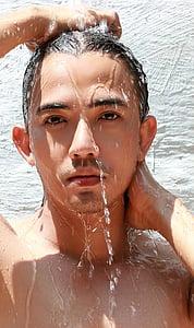 man showering near wall