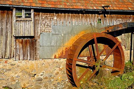 round brown metal wheel during daytime