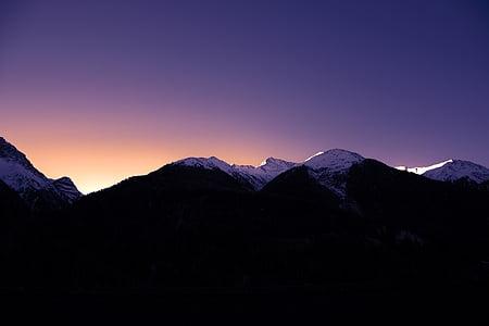 silhouette of black and white mountain range