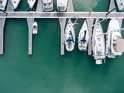 aerial photo of white yachts on water during daytime