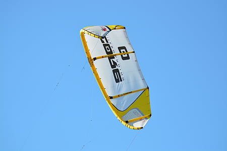 white and yellow parachute on air