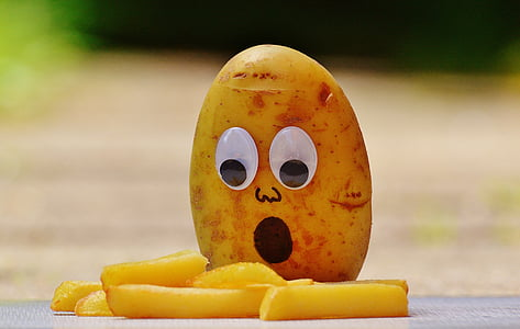 potato with googly eyes and French fries