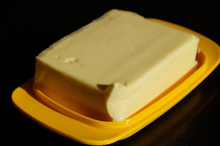 butter on yellow plastic tray