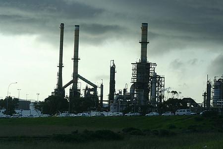 industrial factory under cumulus clouds