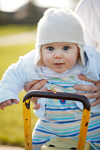 shallow focus photography of person carrying baby