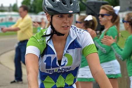 woman wearing black bicycle helmet