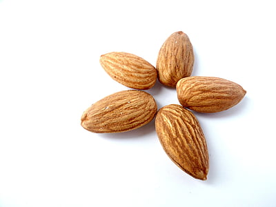 five brown almond nuts formed star