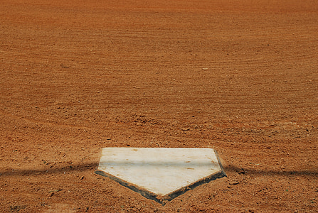 baseball base on brown soil