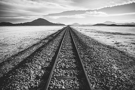 grascale photo of train tracks