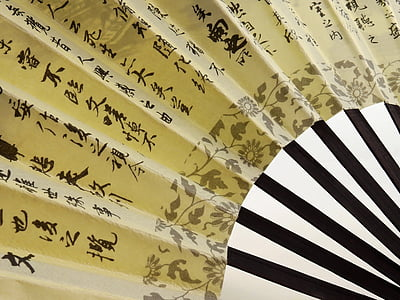 yellow and black hand fan