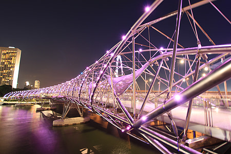 lighted bridge at night time