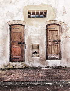 two brown wooden doors are closed