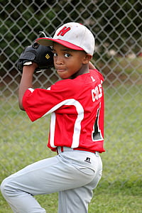 baseball player kid wearing red and white jersey shirt with white pants outfit