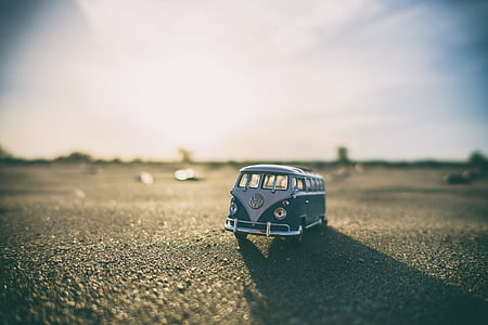 selective focus photography of mini Volkswagen T1 van on road during daytime