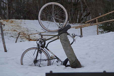 person biking buried in snow