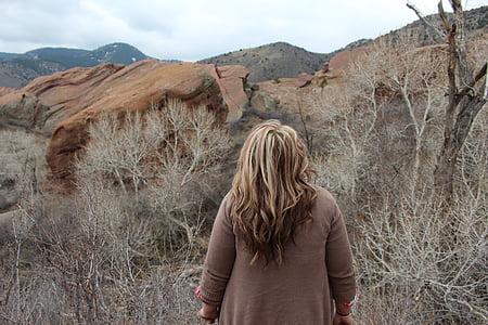 woman wearing jacket facing on mountains