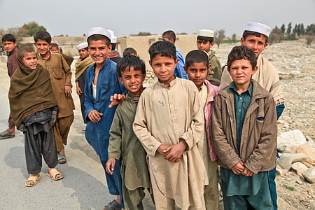 photography of group of kids near street