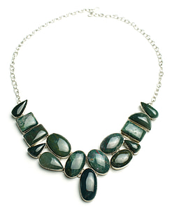 silver-colored chain green gemstone charm necklace