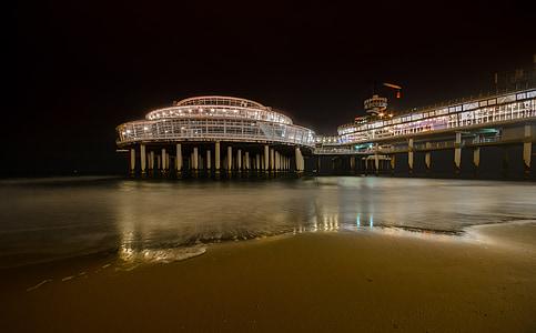 lighted pier near seashore