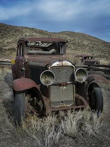 abandoned vintage brown car during daytime
