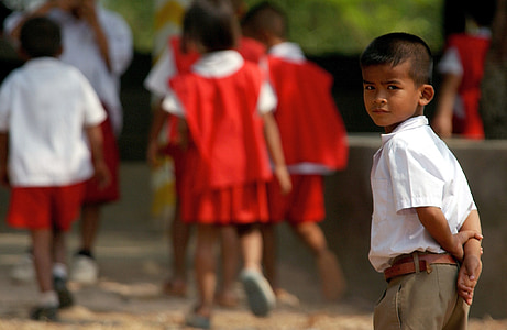 boy wearing white collared shirt and brown bottoms outfit