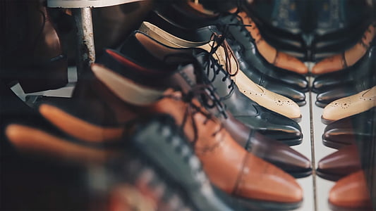 assorted unpaired leather shoes