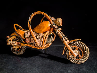 brown wooden miniature motorcycle with black background