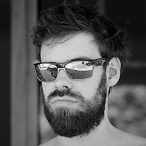 grayscale photography of man in Oakley sunglasses